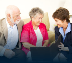 elderly couple having a chat with a senior consultant