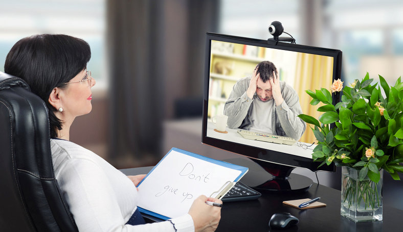 a woman and a man having a video chat