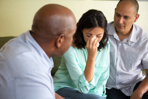 upset woman getting marriage counseling with her husband