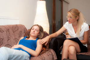 female psychotherapist treats a teenage female patient with normal and cliche ways